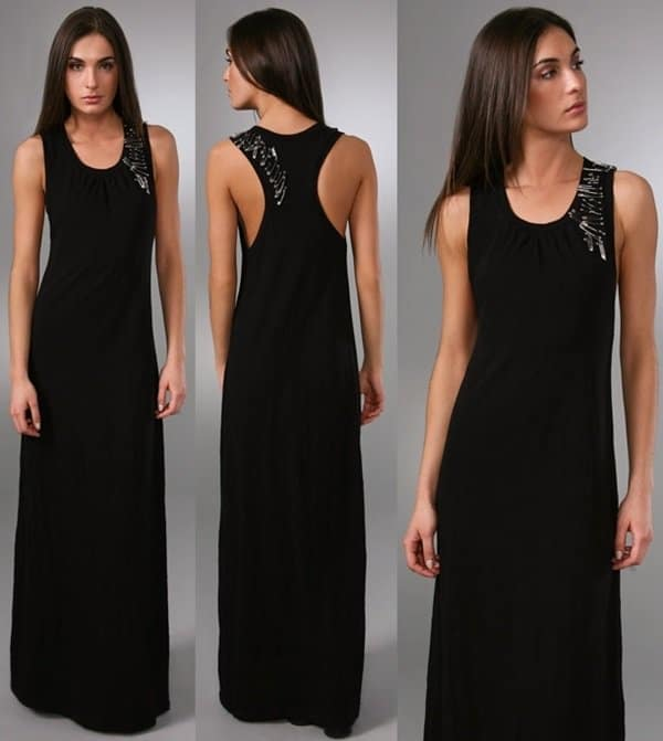 This sleeveless jersey maxi dress features a racer back and safety pin details