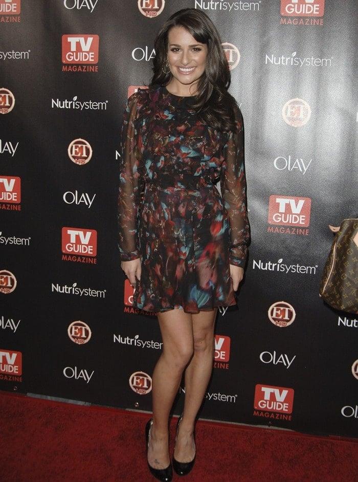 Lea Michele wearing a butterfly printed chiffon long-sleeve dress