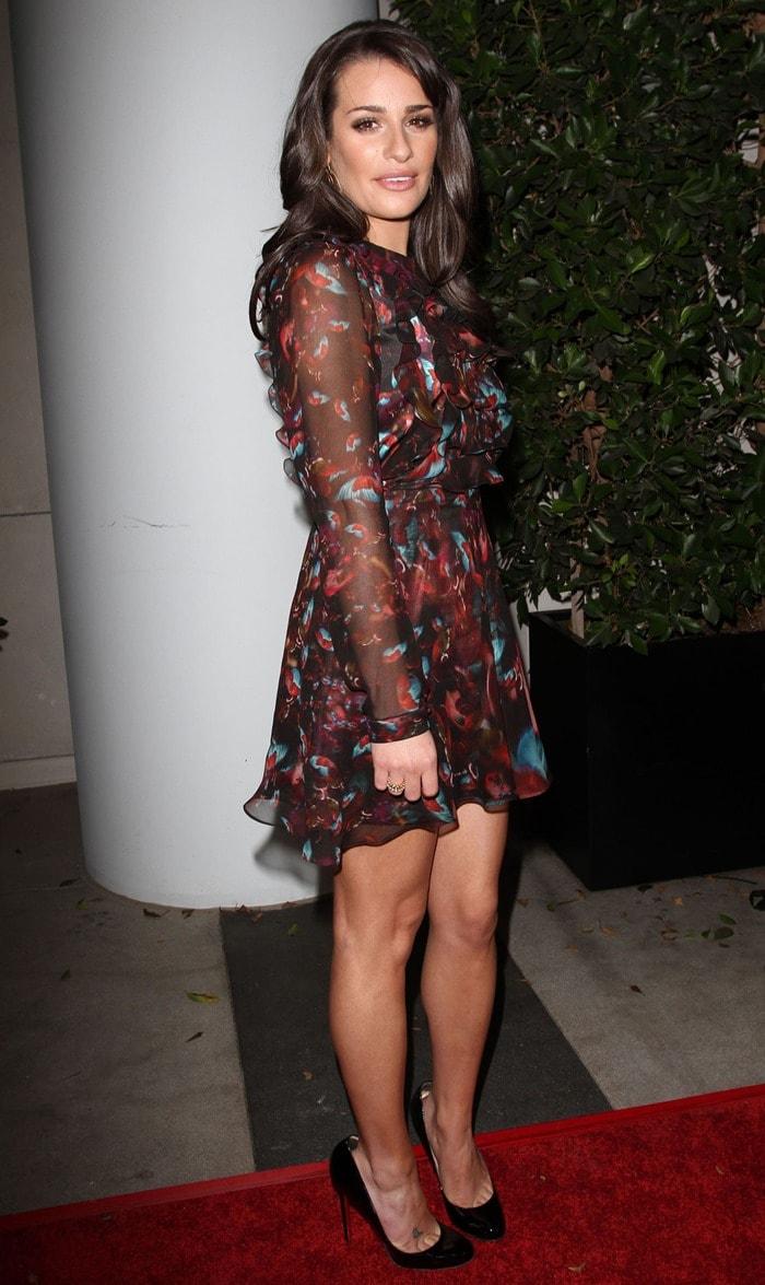 Lea Michele wearing an Erdem Marlene ruffle front dress with black pumps