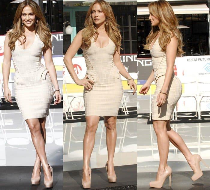 Jennifer Lopez flaunts her legs in a short, skintight geometric dress