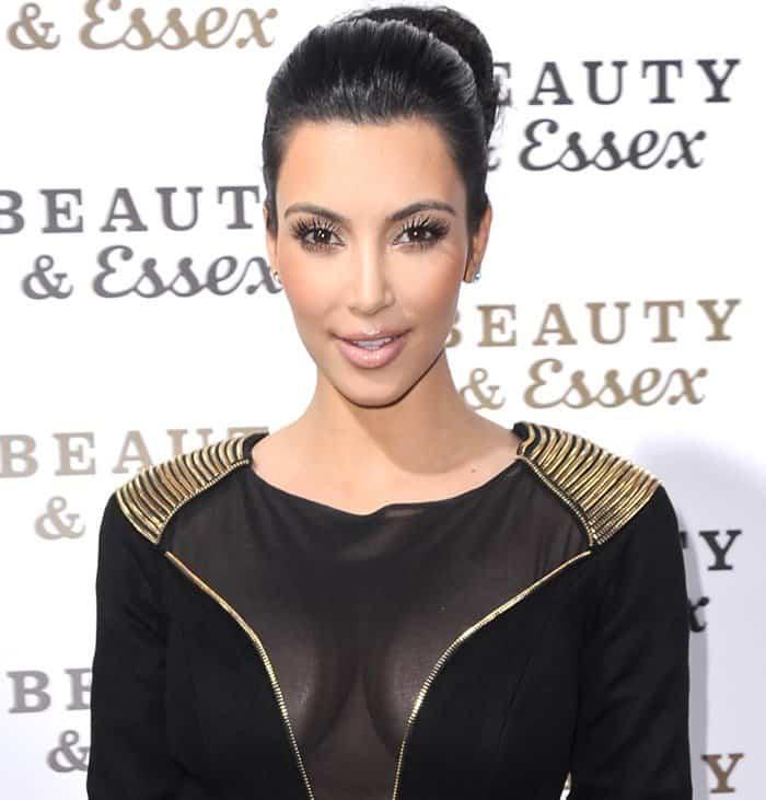 Kim Kardashian's sexy sheer black dress with gold embellishments