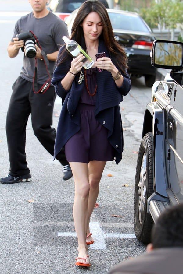 Megan Fox rocks a Parker racerback dress with red sandals
