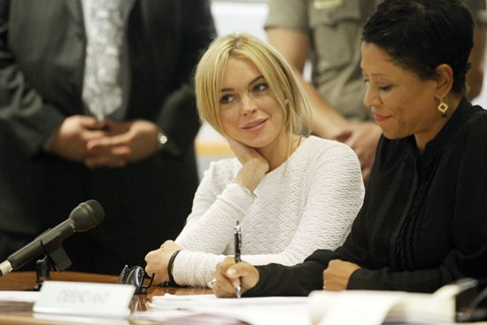 Charged with a felony count of grand theft for allegedly stealing a $2,500 necklace from a jewelry store in Venice, Lindsay Lohan appears at the Airport Courthouse