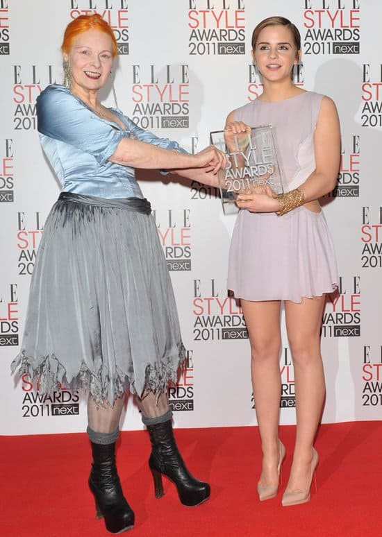 Vivienne Westwood confusedly hands Emma Watson her Elle Style Icon Award as Emma tries to hide her embarrassment at the Elle Style Awards 2011