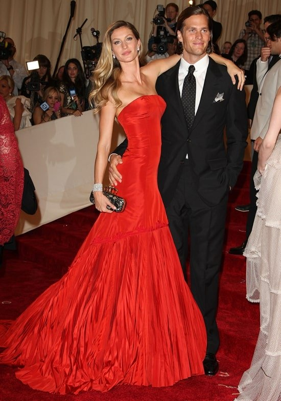 Tom Brady with his wife Gisele Bundchen in Alexander McQueen