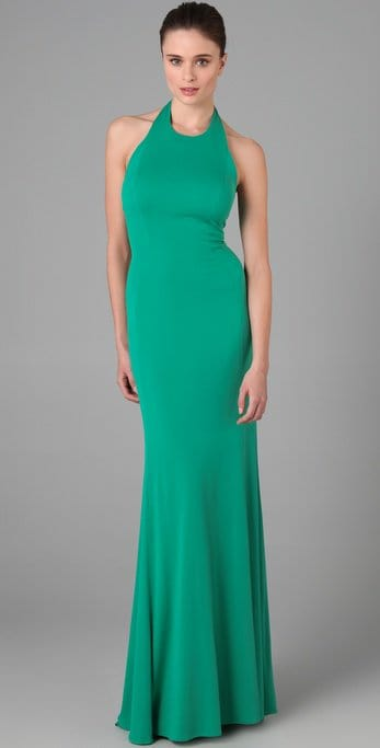 This green silk-jersey halter maxi dress features a crew neck and an open back