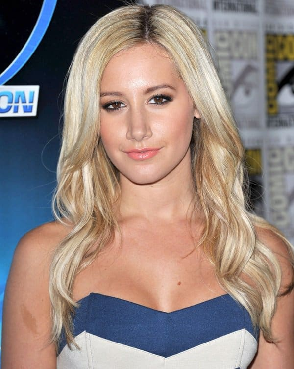 Ashley Tisdale shows off her new nose in a blue and white Lucca Couture zig-zag strapless dress