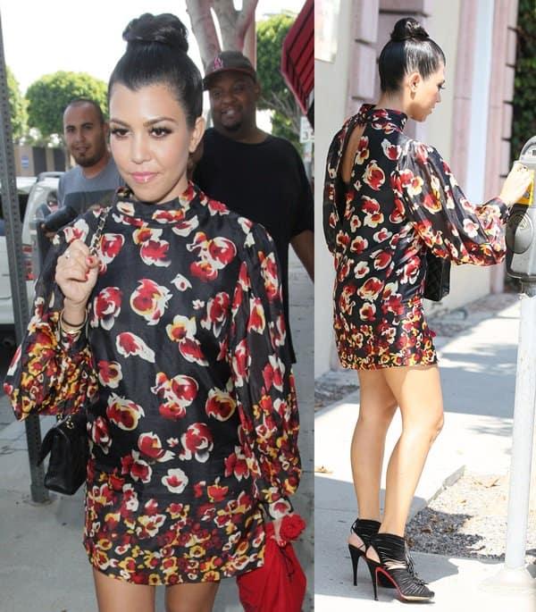 Kourtney Kardashian flaunts her legs in an Aryn K Fire Blossom mini dress while exiting Vera Wang