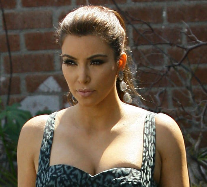 Kim Kardashian is seen in good spirits while shopping for her wedding cake in West Hollywood on July 29, 2011