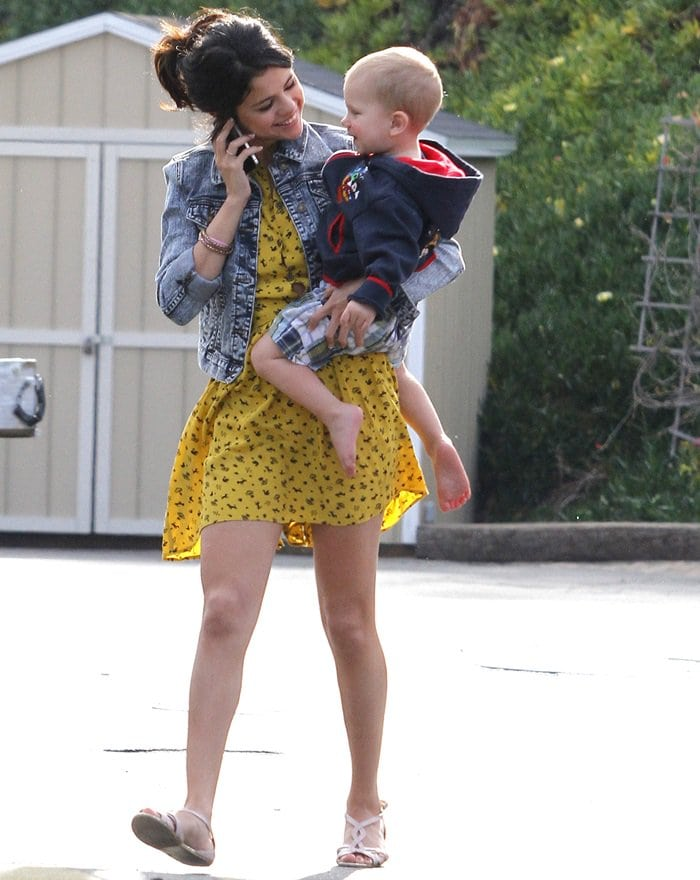 Selena Gomez wears a Topshop Daisy dogs shirtdress