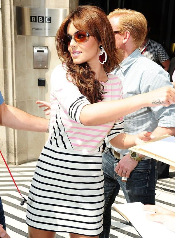 Cheryl Cole signs autographs as she leaves the BBC Radio Studio in London on May 29, 2012