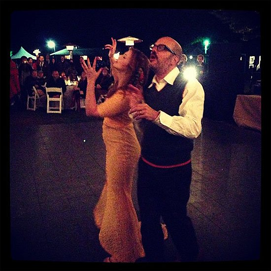 Amber Tamblyn and her husband David Cross dance during their wedding reception in upstate New York on October 6, 2012