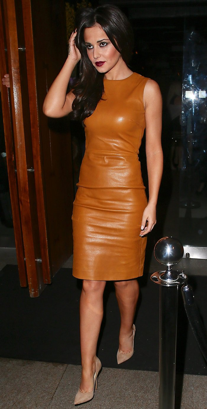 Cheryl Cole flaunts her sexy legs in a tan leather shift dress
