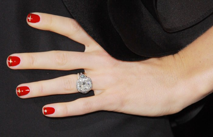 Jessica Biel showing off her engagement ring from Brilliance featuring a large center diamond