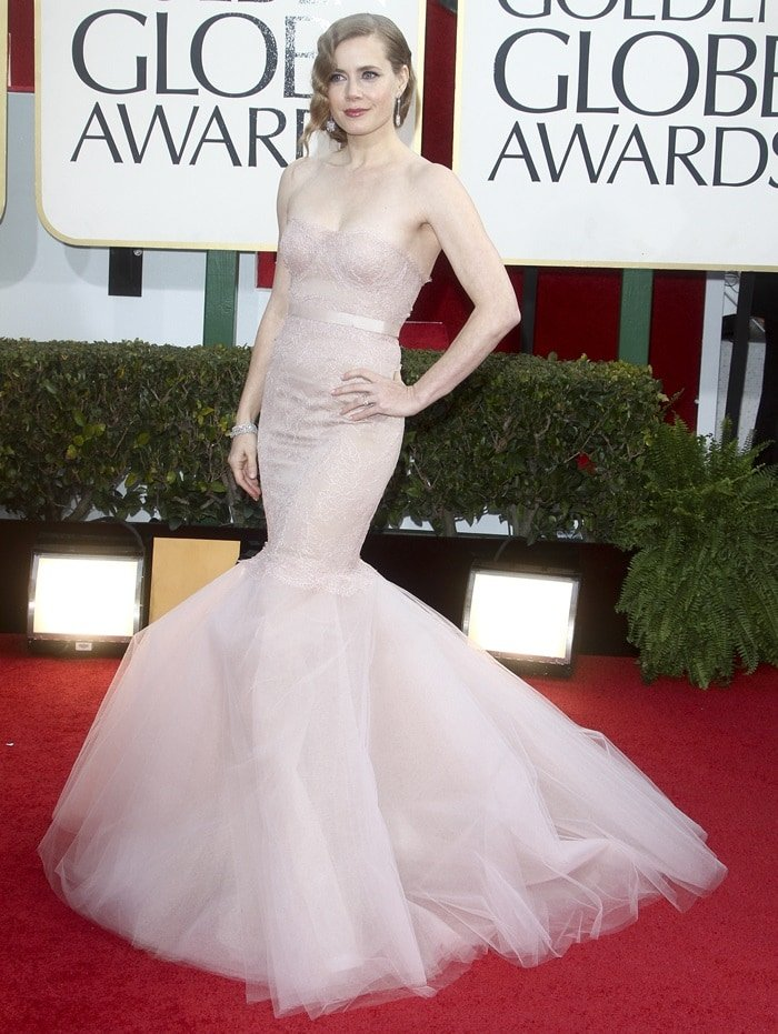 Golden Globe nominee Amy Adams projects old Hollywood glamour in a gown by Marchesafor the 70th Golden Globe Awardsheld at the Beverly Hilton Hotel in Beverly Hills, California on January 13, 2013