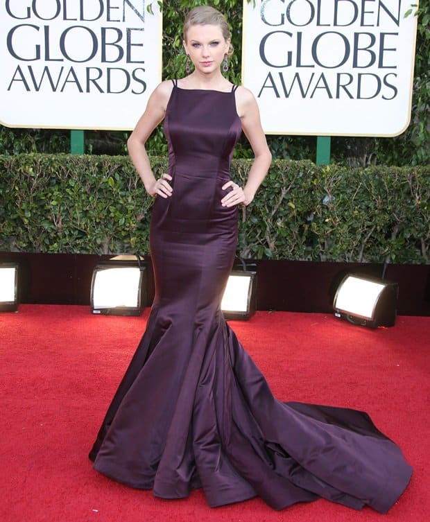 Taylor Swift in a dark plum mermaid cut dress by Donna Karan Atelier