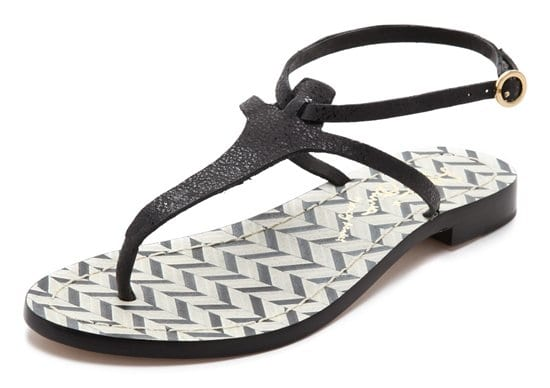 Sleek black/white alice + olivia sandals shimmer with a subtle glaze reflecting from soft leather straps and a footbed of graphic chevron inlays