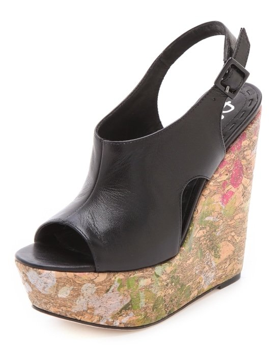 Glossy splashes of color wash across the towering cork wedge of these playful black alice + olivia shoes, while the supple leather upper cradles the foot for a comfortable fit