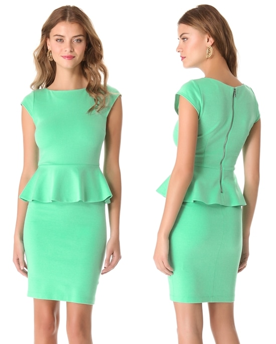 This crew-neck jersey dress from alice + olivia features a ruffled peplum and an exposed back zip