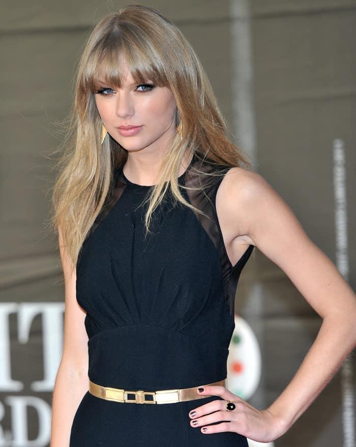 Taylor Swift wearing a sleek Elie Saab Pre-Fall 2013 gown