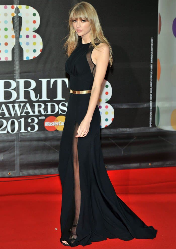 Taylor Swift wearing a gorgeous black sleeveless gown with sheer panels