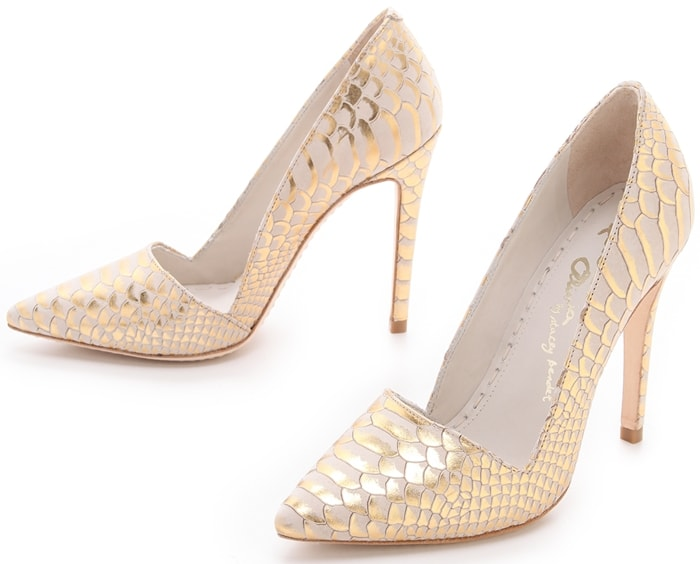 Metallic highlights touch the snake-embossed pattern on these beige nubuck alice + olivia pumps, lending a rock-n-roll edge to the sexy silhouette