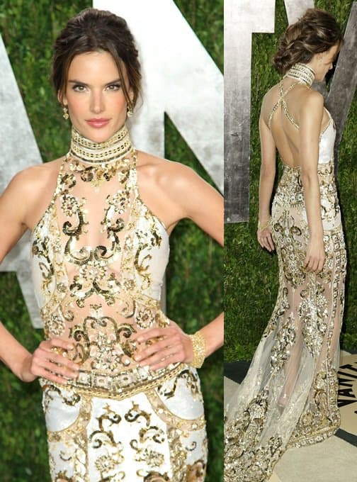 Alessandra Ambrosio wore a white sleeveless dress by Zuhair Murad featuring a high neckline and gold embroidered beadwork detail