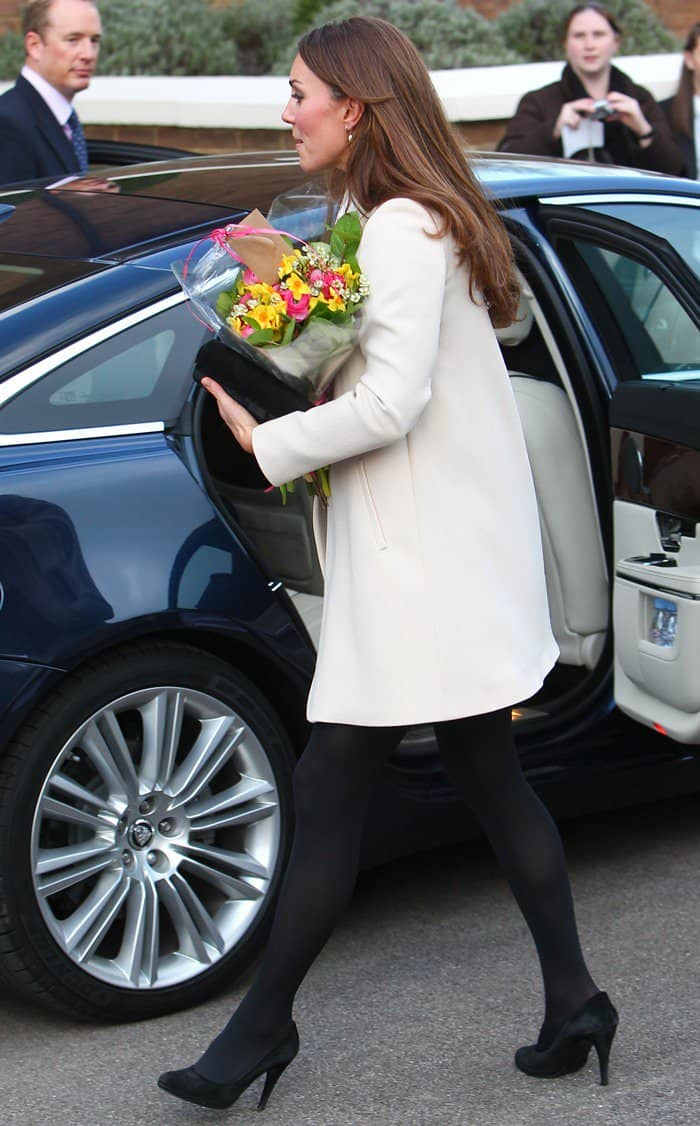 Kate Middleton wearing a Peter Pan–collared shift dress from Topshop, black tights, and black pumps
