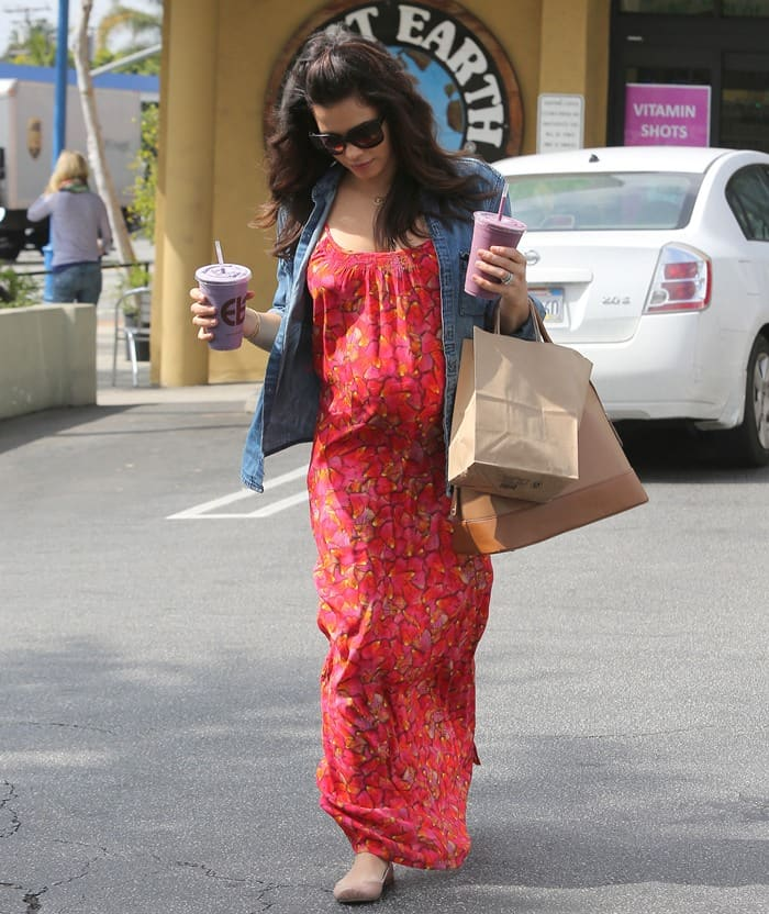 Pregnant wearing a very spring-appropriate maxi dress
