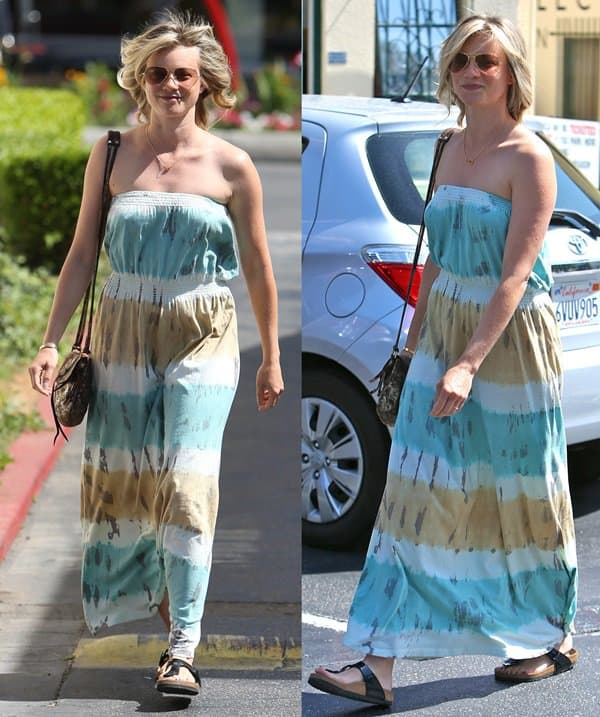 Amy Smart wearing a strapless tie-dye maxi, some sandals, and a neat cross-body purse