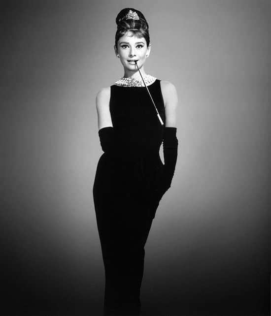 Audrey Hepburn as Holly Golightly in the iconic black dress by Givenchy
