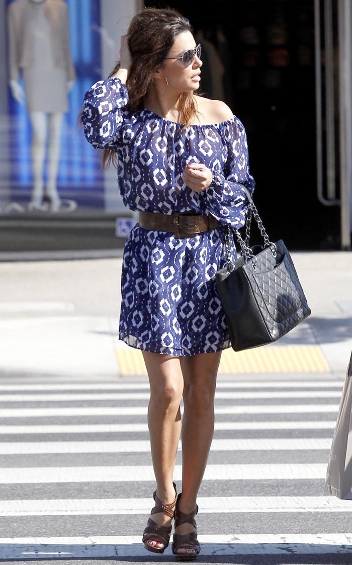 Eva Longoria flaunts her legs ina Show Me Your Mumu's Lily scrunch dress