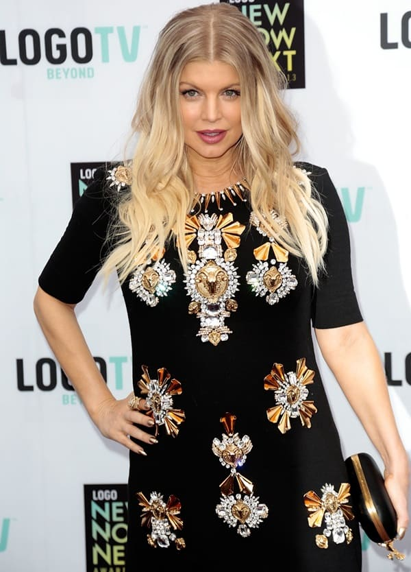 Fergie wore a sleeveless Fausto Puglisi dress featuring a funnel neck, exaggerated slits at the front and jewel ornaments at the front