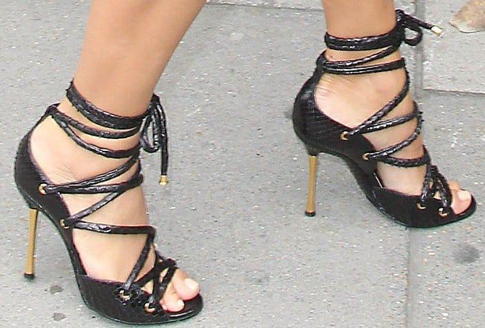 Kim Kardashian wearing black lace-up heels