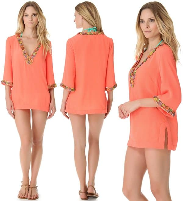 Vibrant thread secures rustic wooden beads as they trace the plunging V neckline and cuffs of this crinkled coral tunic