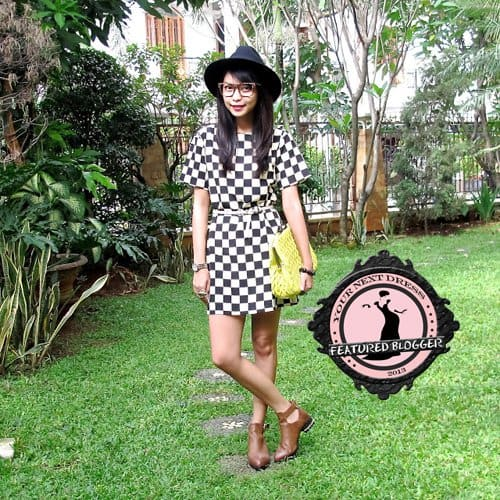 Adelle cinched her checkered dress at the waist to give it more form