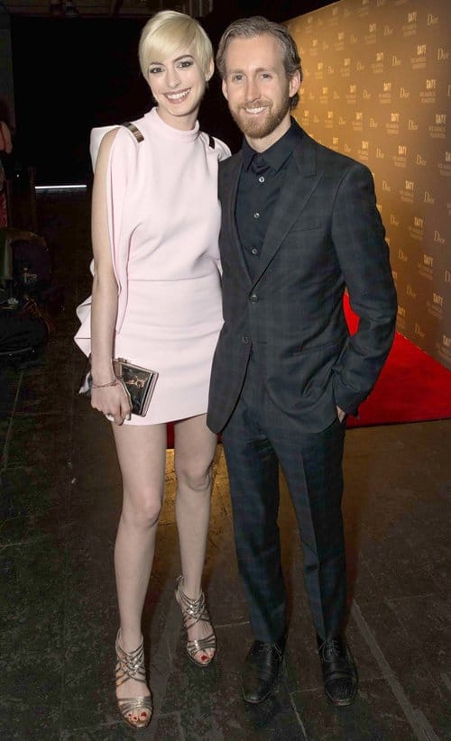 Anne Hathaway with husband Adam Shulman smiling for the cameras