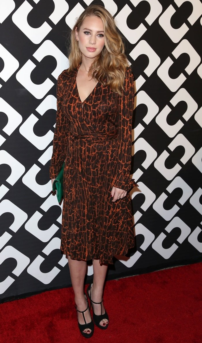 Dylan Frances Penn, the daughter of Sean Penn and Robin Wright, in an orange animal print wrap dress