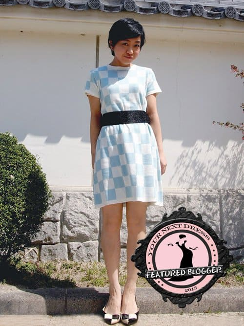 Nana wearing a powder blue checked dress with chic flats