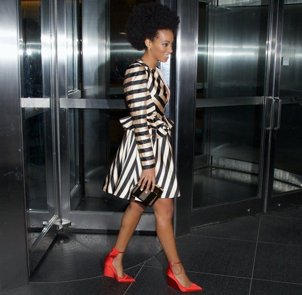 Solange Knowles flaunts her legs in her bright red Burberry Prorsum Crayford shoes