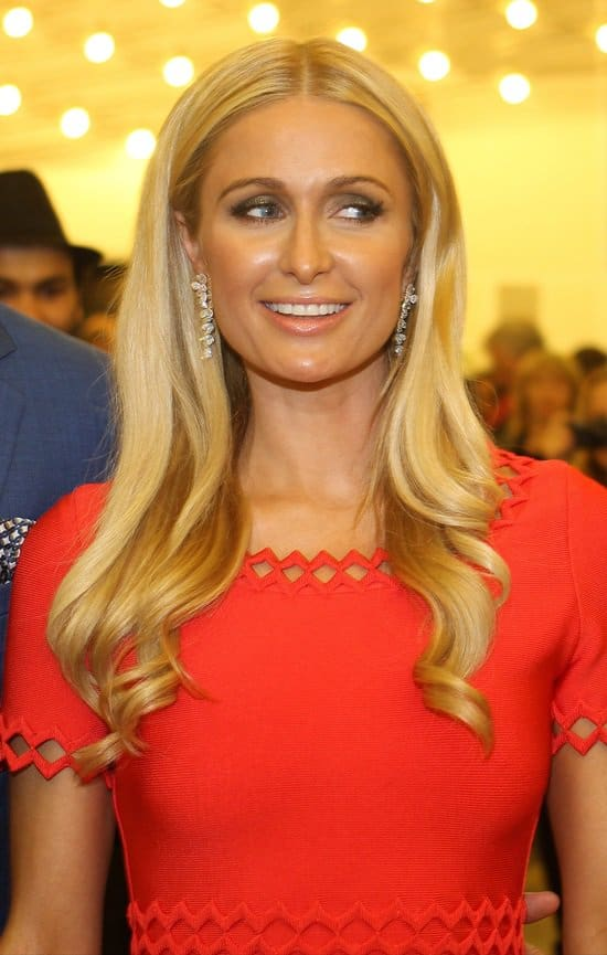 Paris Hilton wears a lovely red dress at the Cannes Film Festival