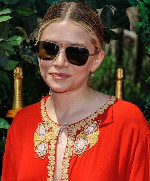 Ashley Olsen wearing a red kaftan that was two sizes too big for her