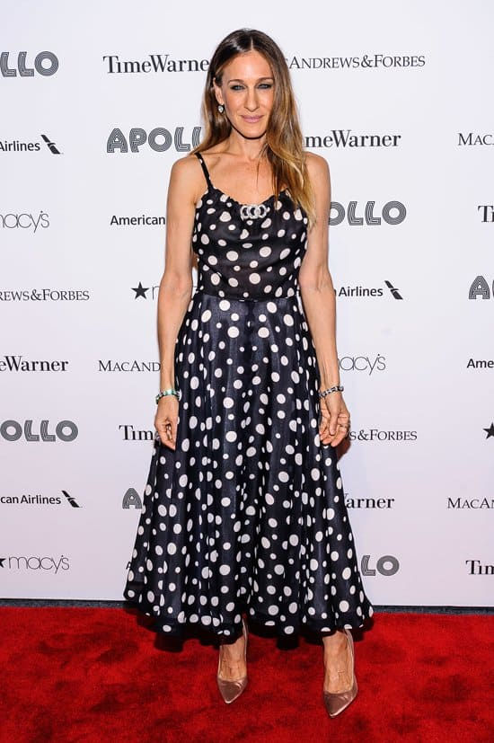 Sarah Jessica Parker wears a polka-dot Lanvin dress, Manolo Blahnik shoes, an ALC jacket, and FL and Fenton jewelry