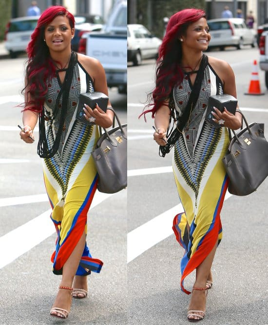 Red-haired Christina Milian walking the streets in a merry maxi dress
