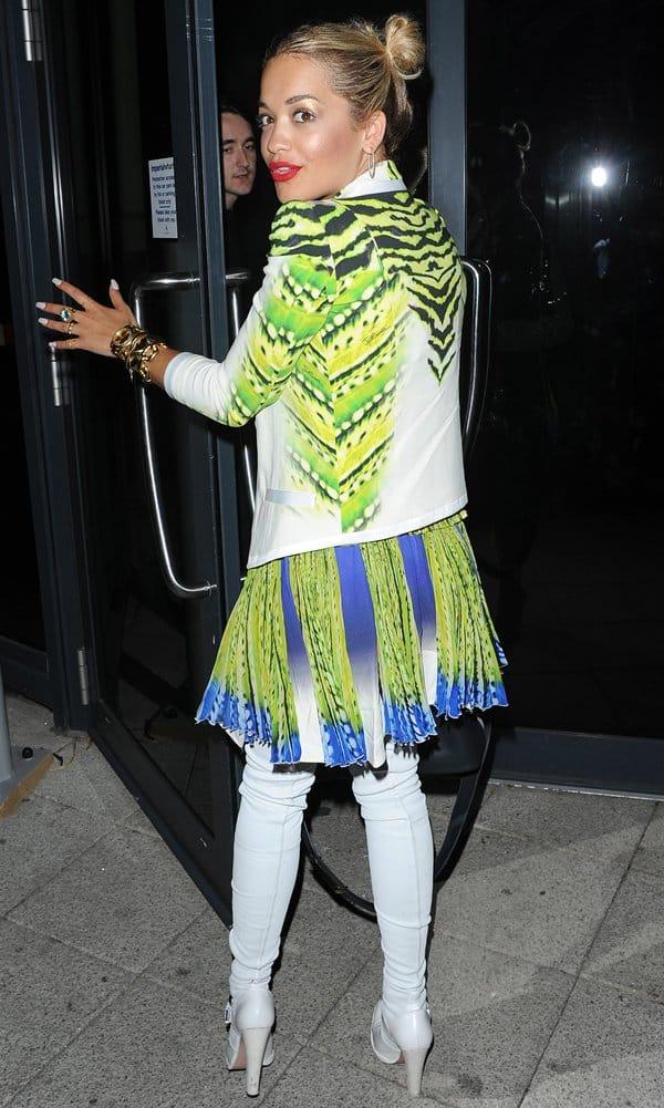 Rita Ora'sChun Li hair andbright green Just Cavalli dress