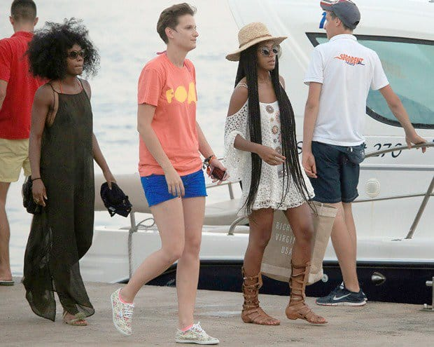 Making sure not to waste any time to soak up the sun, Solange came already dressed for the occasion and location in a cutout-shoulder crochet dress, a straw hat, cat-eye sunglasses, and trendy tall gladiator sandals