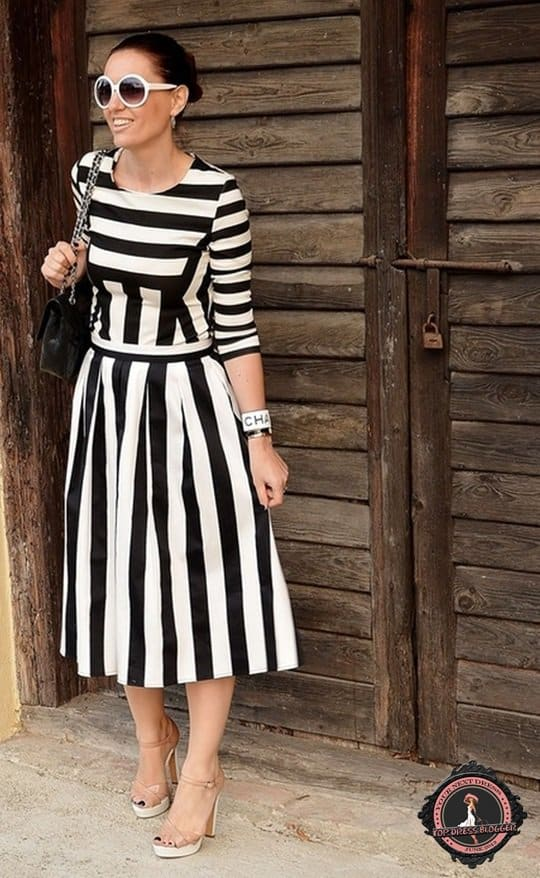 Claudine nails a classy striped look