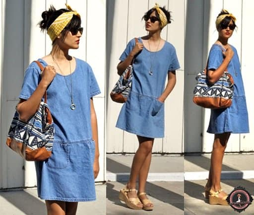 Ashley teams her plain denim dress with a headscarf, printed tote, and wedge sandals