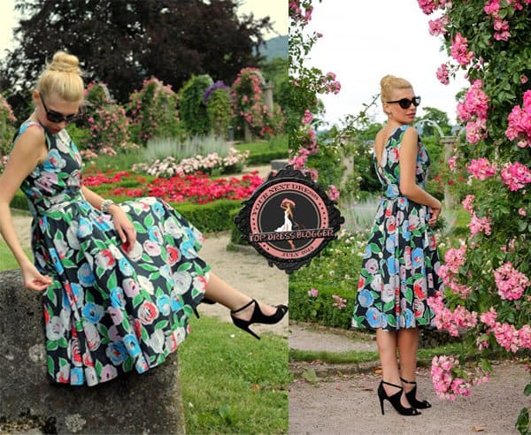 Andy looks lovely in her floral dress and black peep-toe pumps