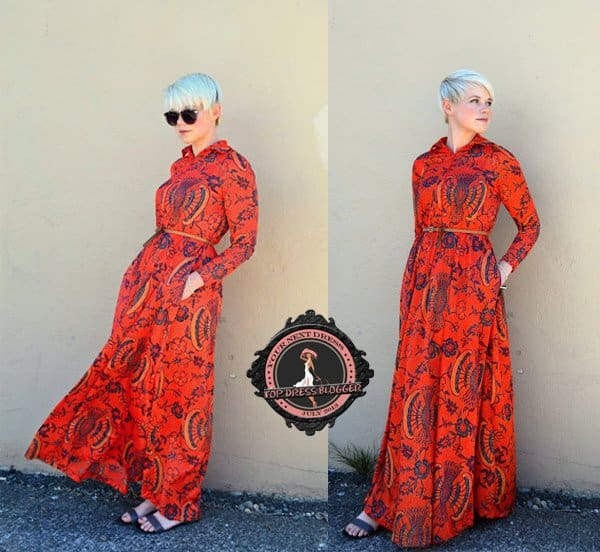Catie stands out in a bright orange printed maxi dress